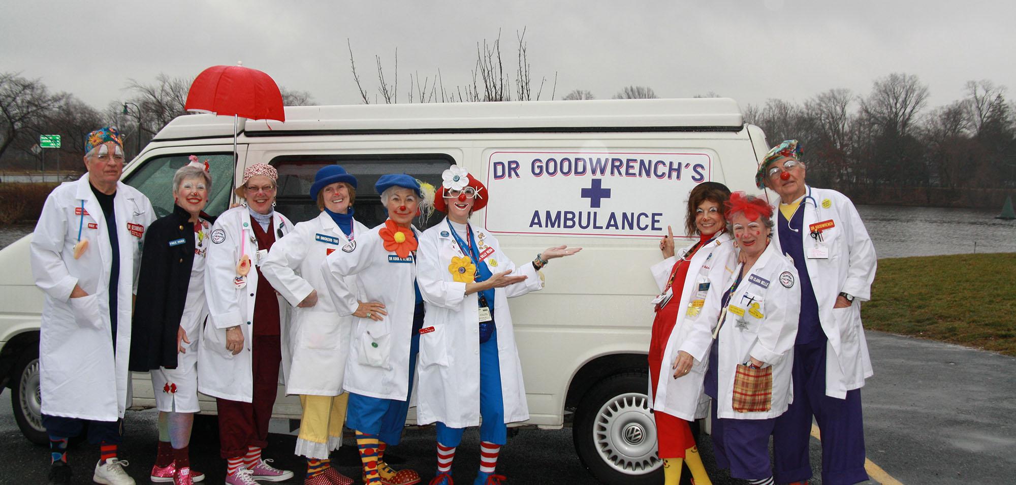Clowns with clown ambulance.