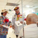 Clowns visiting a patient.